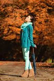 Girl walking with umbrella in autumnal park Royalty Free Stock Photo