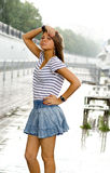 Girl walking under rain Royalty Free Stock Photography
