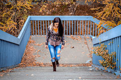 Girl walking up the stairs. On a beautiful autumn day Royalty Free Stock Photos