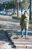 Girl walking up the stairs. In a sunny spring day Royalty Free Stock Photos