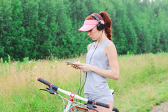 Girl walking in a warm day in the nature with a bike, Stock Image