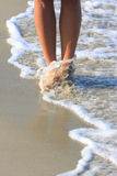 Girl walking in water Royalty Free Stock Photography