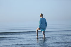 Girl walking in the water Stock Image
