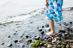 Girl walking in water Stock Images