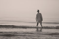 Girl walking in the water Royalty Free Stock Photography