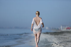 Girl walking in the water Royalty Free Stock Images
