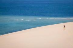 Girl walking on the white dunes on the Bazaruto Island Stock Photo