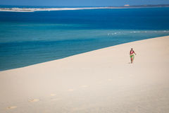 Girl walking on the white dunes on the Bazaruto Island Stock Photography