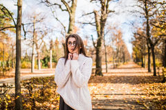Girl walking in windy autumn park Royalty Free Stock Image