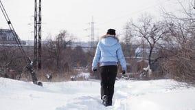 Girl walking in winter stock video