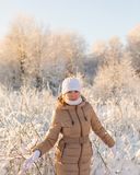 Girl walking in winter forest Royalty Free Stock Photos