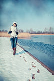 Girl walking at winter lake Royalty Free Stock Images