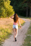 Girl walks. On a footpath Stock Photo