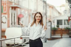 Beautiful girl in the city stock photography
