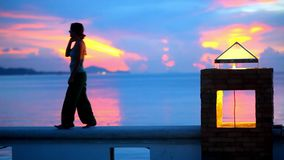 Girl walks and away from the camera at sunset near. The sea. Video 1920*1080 stock video footage