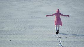 Girl walks away with her hands up stock footage