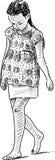 Girl walks barefoot on the beach Royalty Free Stock Photo