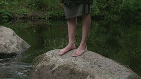 Girl walks barefoot in the woods in a cloak stock video