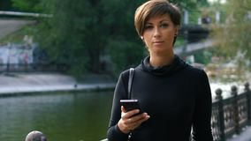 Woman is using a smartphone at outdoor. stock footage