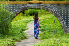 Girl walks through a gate Royalty Free Stock Photos