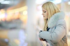 Girl walks through the Mall. Girl walks to the shops Royalty Free Stock Photos