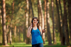 Girl walks in the park Royalty Free Stock Photo
