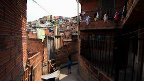 Girl walks in poor neighborhood in Latin America stock video footage