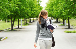 The girl walks, reading the book Royalty Free Stock Images