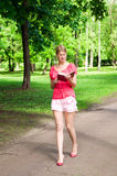 The girl walks and reads Stock Photo