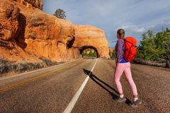 Girl walks on road near Red canyon during summer Stock Photos
