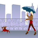Girl walks with small dog. Young modern girl-blonde walks with small dog by bridge. She smiles. Behind them are beautiful forged tracery grating and silhouette Stock Photos