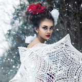 Girl walks in the snow Royalty Free Stock Image
