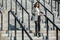 Girl walks on stair Royalty Free Stock Photos