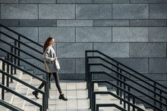 Girl walks on stair Royalty Free Stock Photography