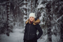 Girl walks on the winter forest Royalty Free Stock Photos