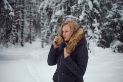 Girl walks on the winter forest Stock Photo