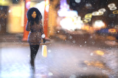 Girl walks in winter night  city Royalty Free Stock Image