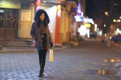 Girl walks in winter night  city Stock Photos