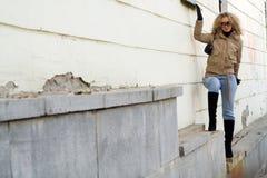 Girl at wall Royalty Free Stock Photos