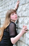 Girl and wall Royalty Free Stock Images