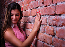 Girl and a wall background Royalty Free Stock Images