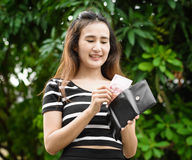 Girl with wallet Royalty Free Stock Photos