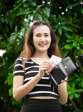 Girl with wallet Stock Images
