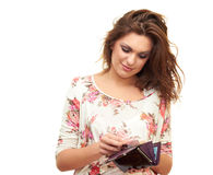 Girl with wallet in hand Stock Image