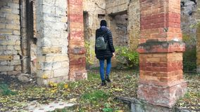 A girl wanders around an abandoned house. 4K. A girl wanders around an abandoned house. Abandoned mansion.Old building.4K stock video footage