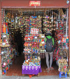 Girl want to buy something in souvenir shop Royalty Free Stock Image