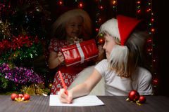 Girl wants to give the gift of an older sister Stock Photos