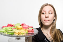 A girl wants to taste the cookies. A girl wants to taste the cookies and licks her lips Stock Photos