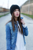 Girl in warm cap Stock Images