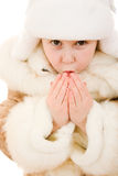 The girl in warm clothes blowing on his hands Stock Photos